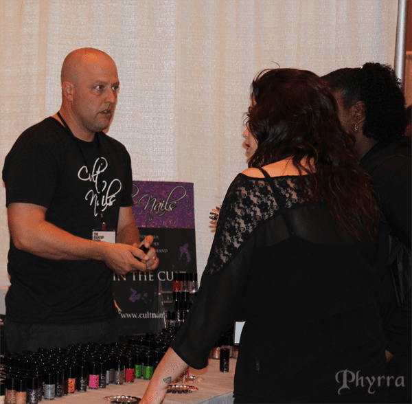 J selling at the Cult Nails Booth