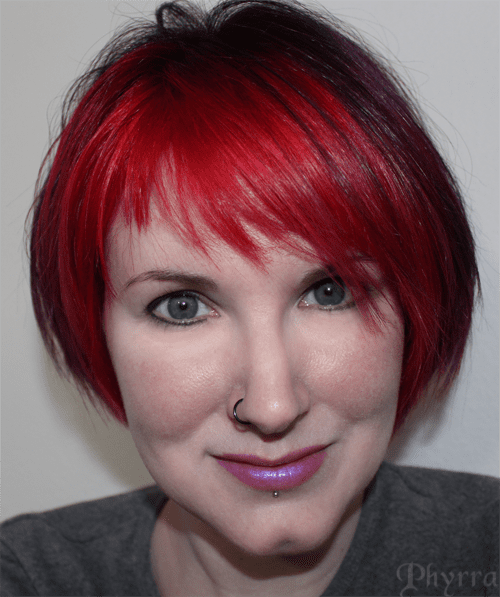 Longer crown, stacked back, asymmetrical fringe with manic panic vampire red