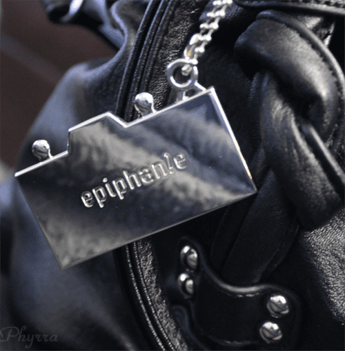 The back of the epiphanie bags charm