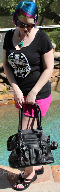 Holding the Epiphanie Lola black camera handbag purse