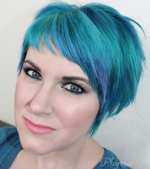 Wearing Urban Decay Revolution Lipstick in Native and Performance Colors Snowie Foundation and Darling Girl Blue Flame