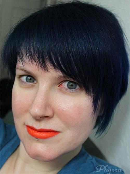 Wearing only Melt Cosmetics Bang Bang Lipstick
