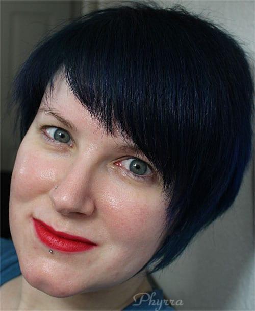 Wearing only Melt Cosmetics Belladonna Lipstick