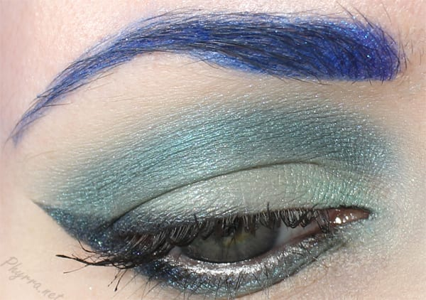 Wearing Buyer's Remorse on the lid and lower lash line, Mermaid's Plumage in the crease, Celestial Crow as liner and outer lower lash line, Grandiloquent at the inner corner.