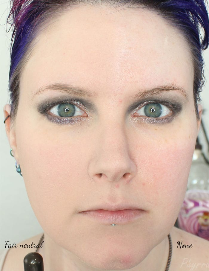 Wearing Urban Decay Naked Skin Ultra Definition Powder Foundation in Fair neutral on the left side of the picture
