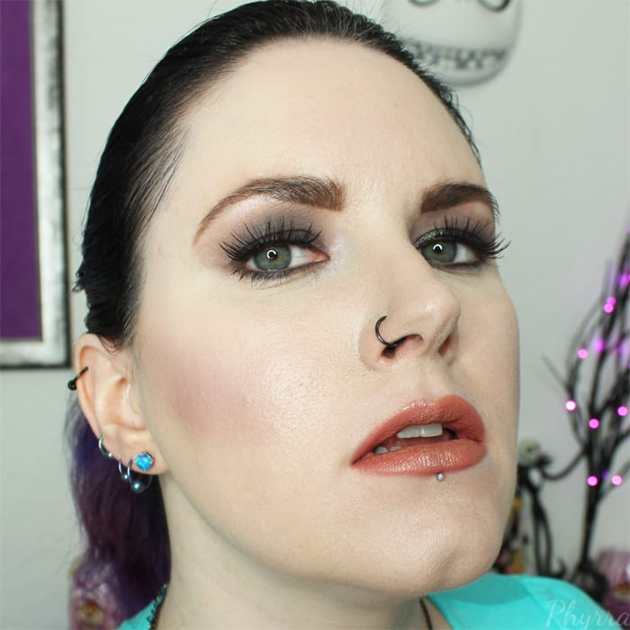 Wearing Urban Decay eyeshadow, blush and lipstick
