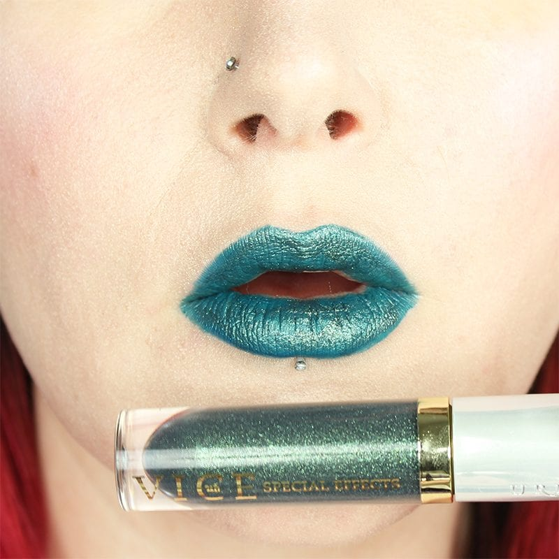 Urban Decay Vice Special Effects Lipstick Topcoat in Circuit on top of Sugarpill U4EA