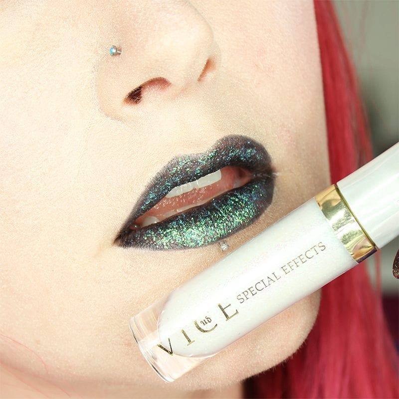 Urban Decay Vice Special Effects Lipstick Topcoat in Litter on top of Perversion Vice lipstick