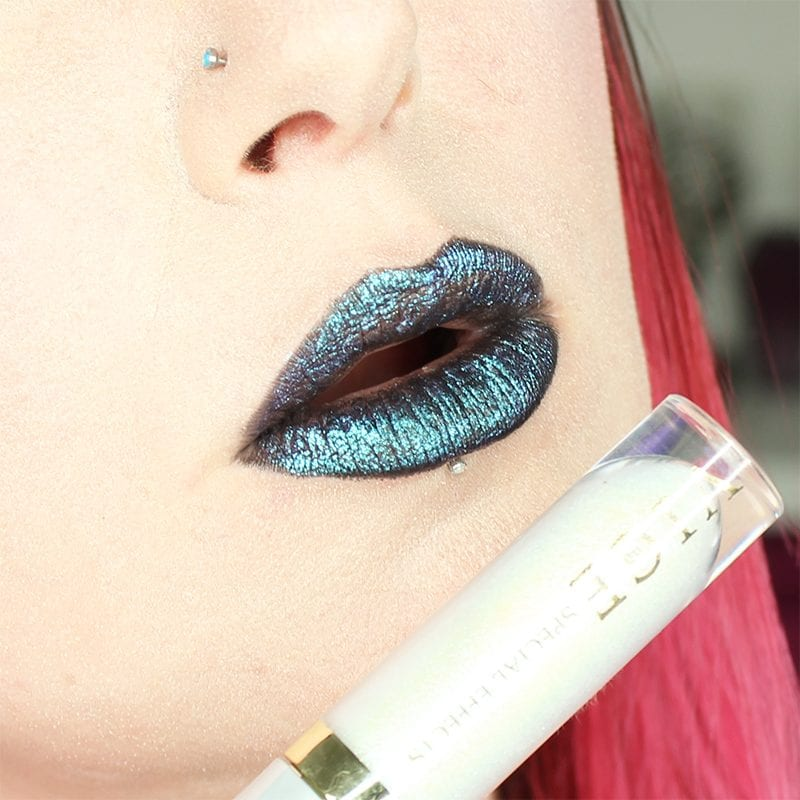 Urban Decay Vice Special Effects Lipstick Topcoat in White Lie on top of Perversion Vice lipstick