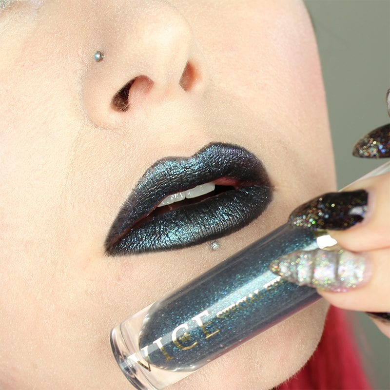 Urban Decay Vice Special Effects Lipstick Topcoat in Ritual on top of Perversion Vice lipstick