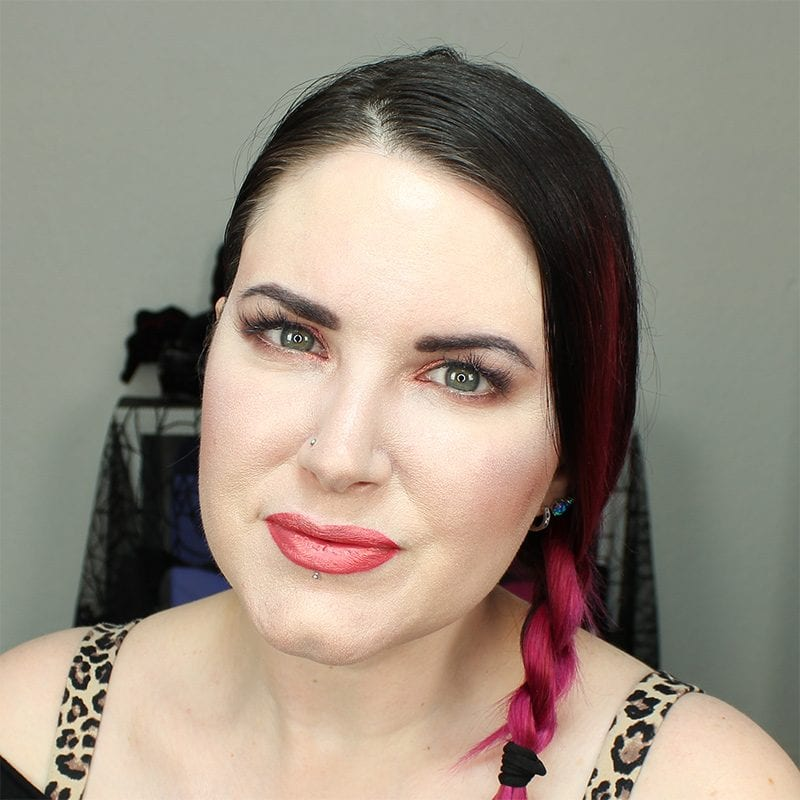 Wearing Kat Von D Beauty X with Saucebox Festival Love Skin Veil on the lips