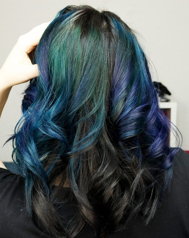 We used Pravana Moody Blue and Locked-In Teal for the front of my hair, Pravana Vivids Blue mixed with a touch of Vivids Violet for the middle section, Pravana Green mixed with Blue to make teal for the back section and then permanent black for the bottom section.