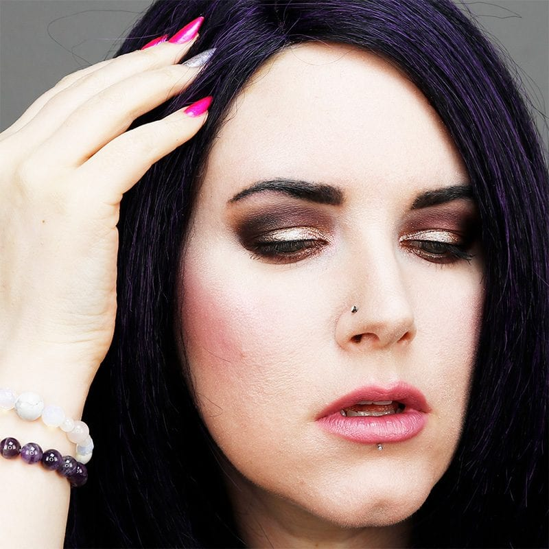 Wearing Urban Decay Violet lipstick