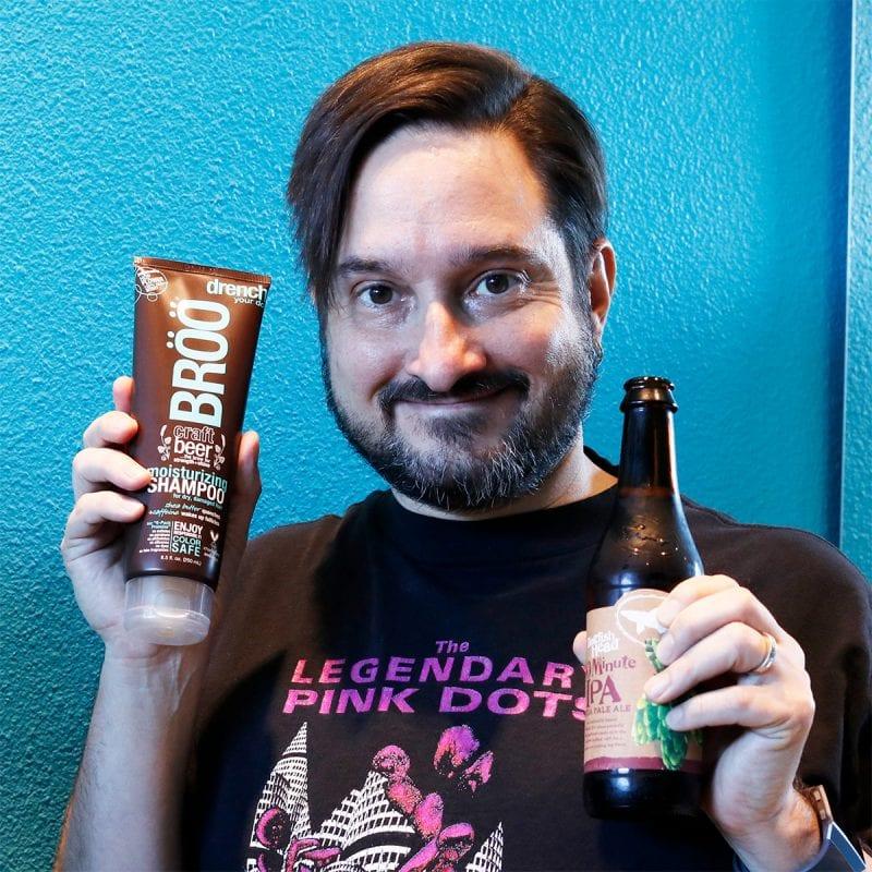 Ray holding the BRÖÖ Moisturizing Craft Beer Shampoo