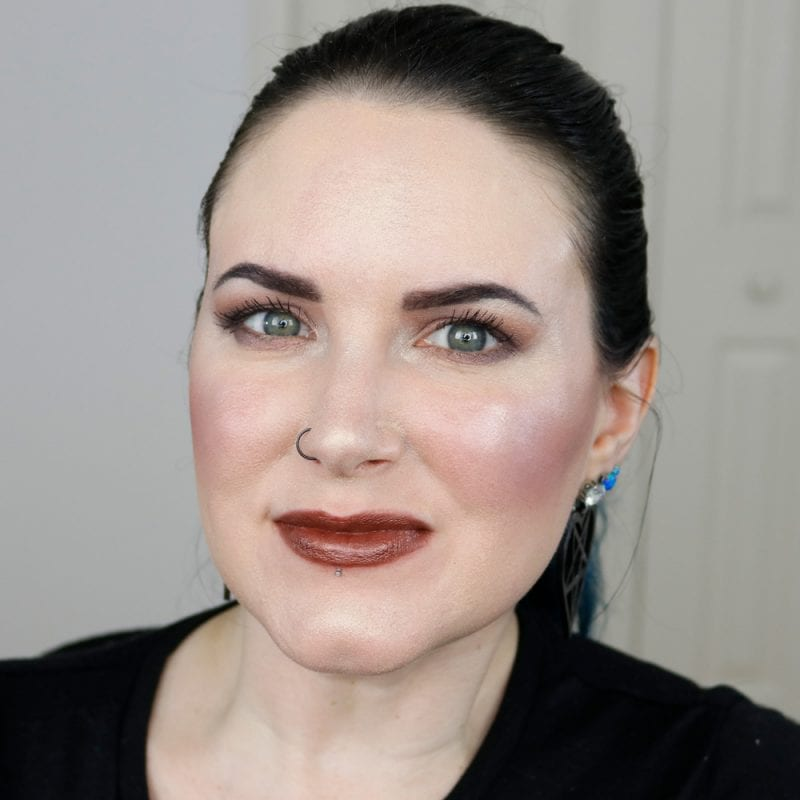 Urban Decay Naked Heat Vice Lipstick in Ember swatched on pale skin