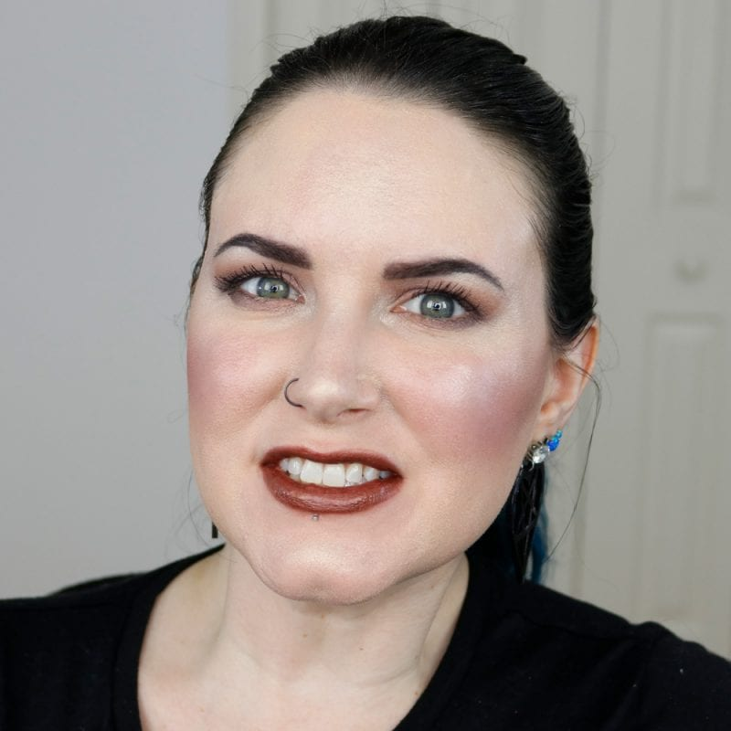 Urban Decay Naked Heat Vice Lipstick in Ember swatched on fair skin