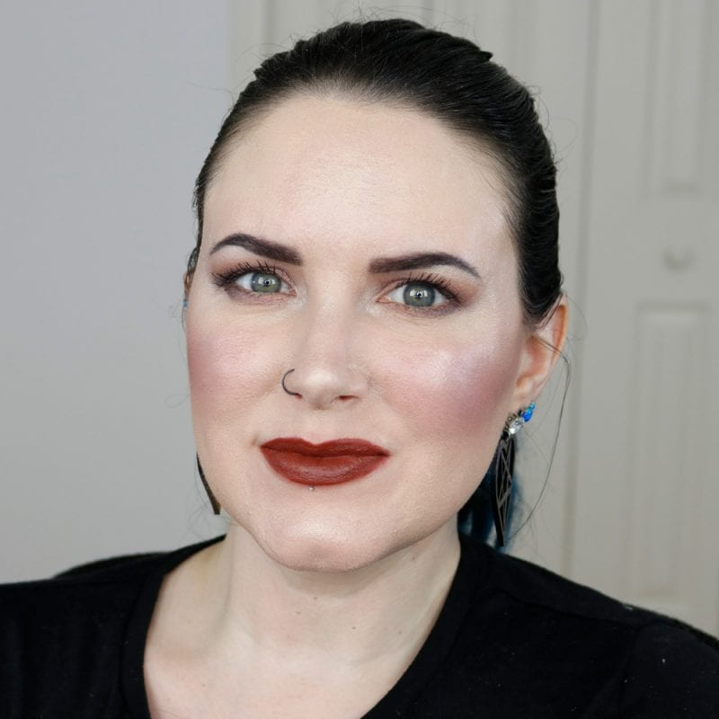 Urban Decay Naked Heat Vice Lipstick in En Fuego swatched on pale skin