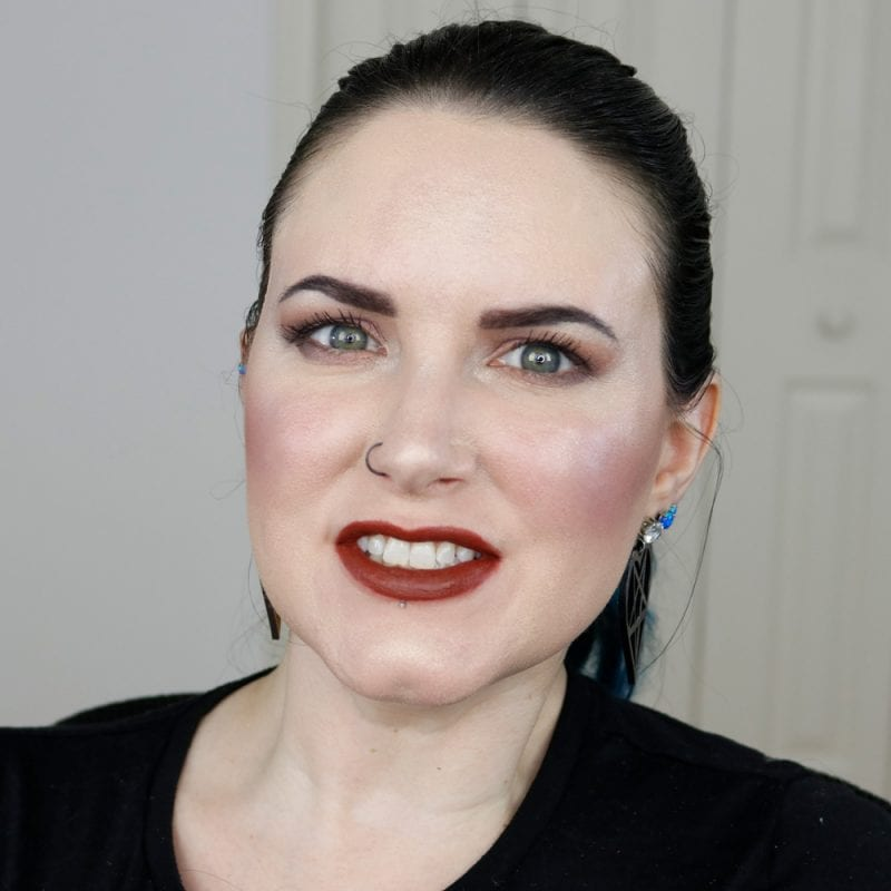 Urban Decay Naked Heat Vice Lipstick in En Fuego swatched on fair skin