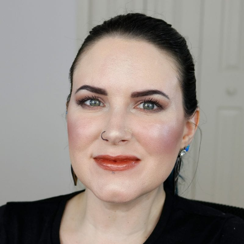 Urban Decay Naked Heat Vice Lipstick in Faith swatched on pale skin