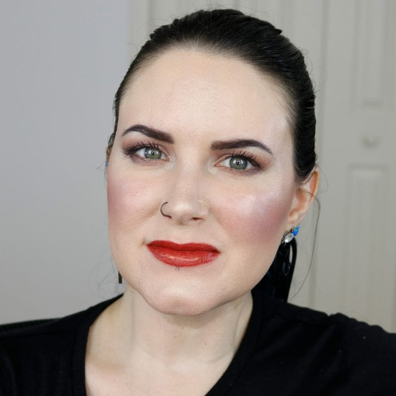 Urban Decay Naked Heat Vice Lipstick in Heat swatched on pale skin
