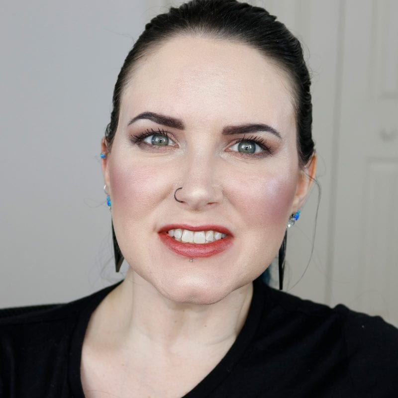 Urban Decay Vice Lipstick in Outspoken swatched on pale skin