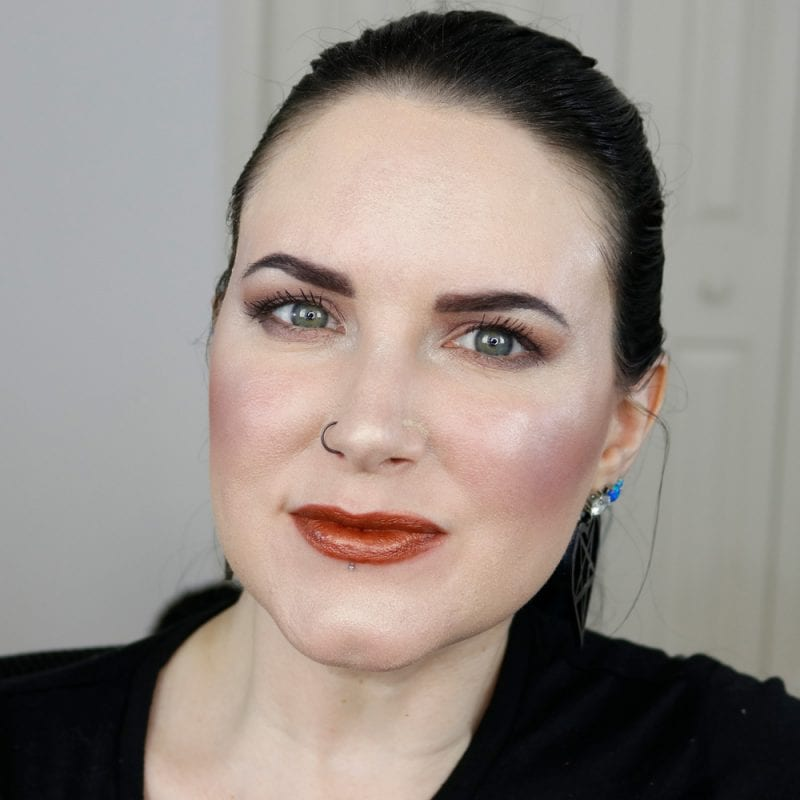 Urban Decay Naked Heat Vice Lipstick in Scorched swatched on pale skin