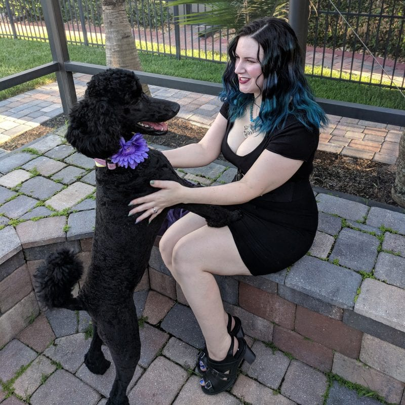 Wearing my sexy goth dress and holding my goth puppy