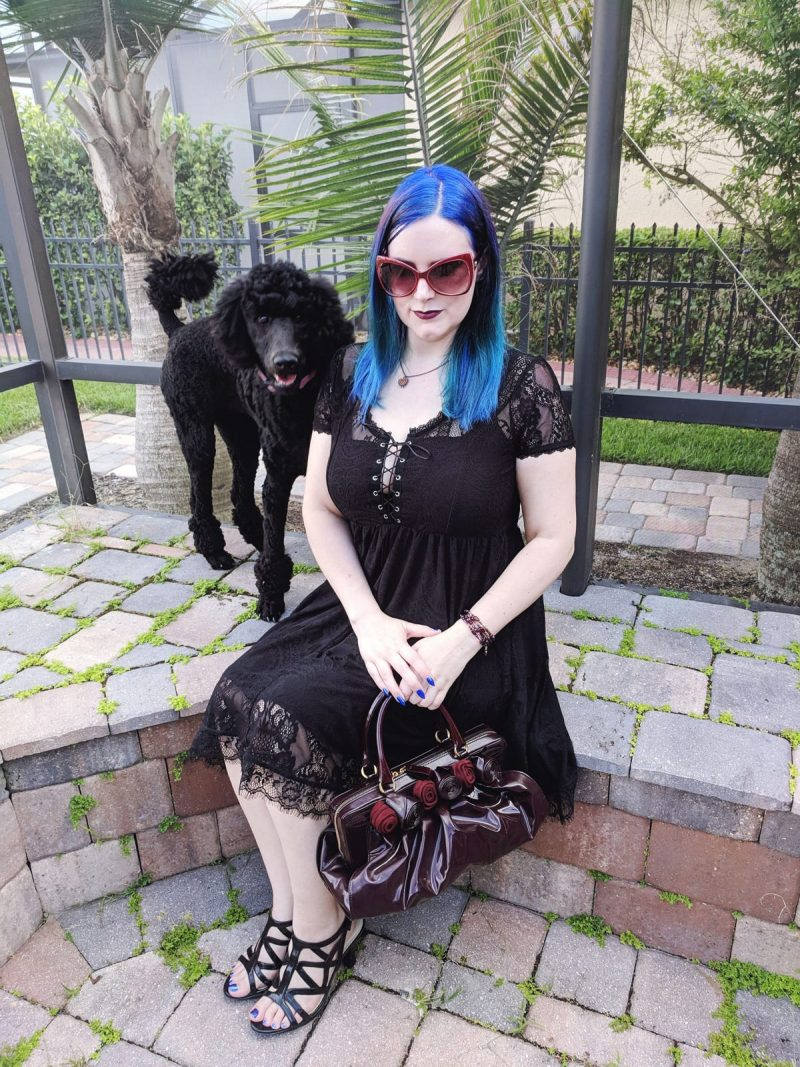 Courtney is wearing her Killstar Bella Morte Lost Babydoll Dress, holding a Valentino Lacca Fleur handbag in burgundy and Naturalizer Danya Sandals. Her standard poodle puppy Nyx. #plussizefashion #witchystyle #gothicfashion #killstar #LTKCurves