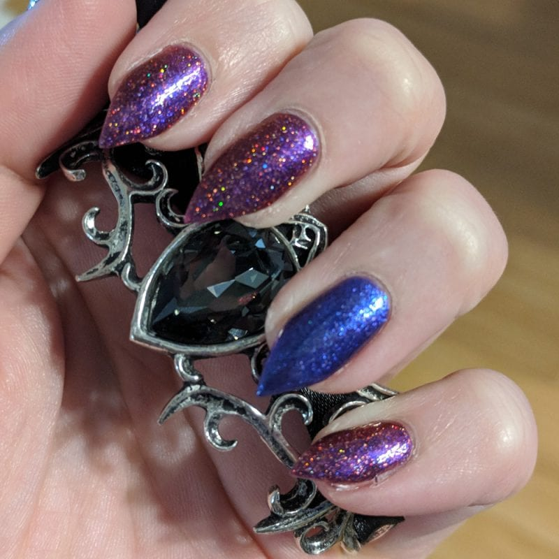 Holding my Alchemy Bat Bracelet