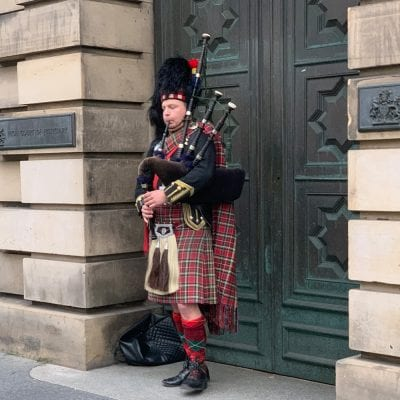 Man in Kilt Playing Bagpipes