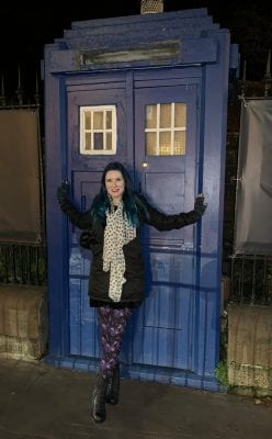 Courtney at the Tardis door