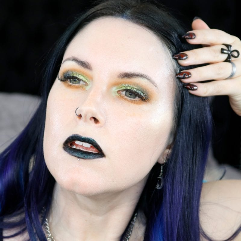 Courtney is wearing Black Moon Orb of Light Palette plus ET and Hydrogen on the eyes, Murmaider on the lips, and Shroom and Squid on the cheeks