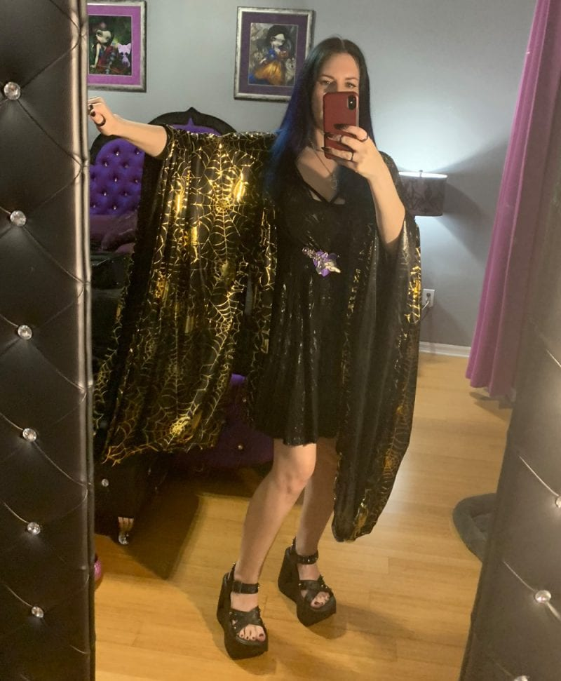 Courtney is wearing a Spellbound Stitches Black and Gold Kimono