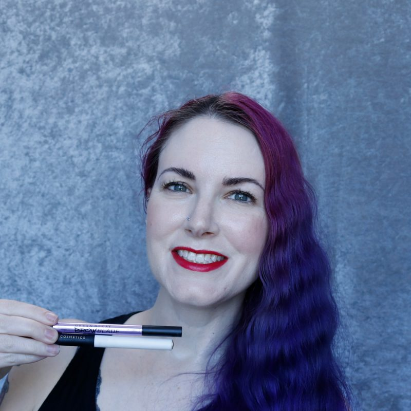 Phyrra holding brow products